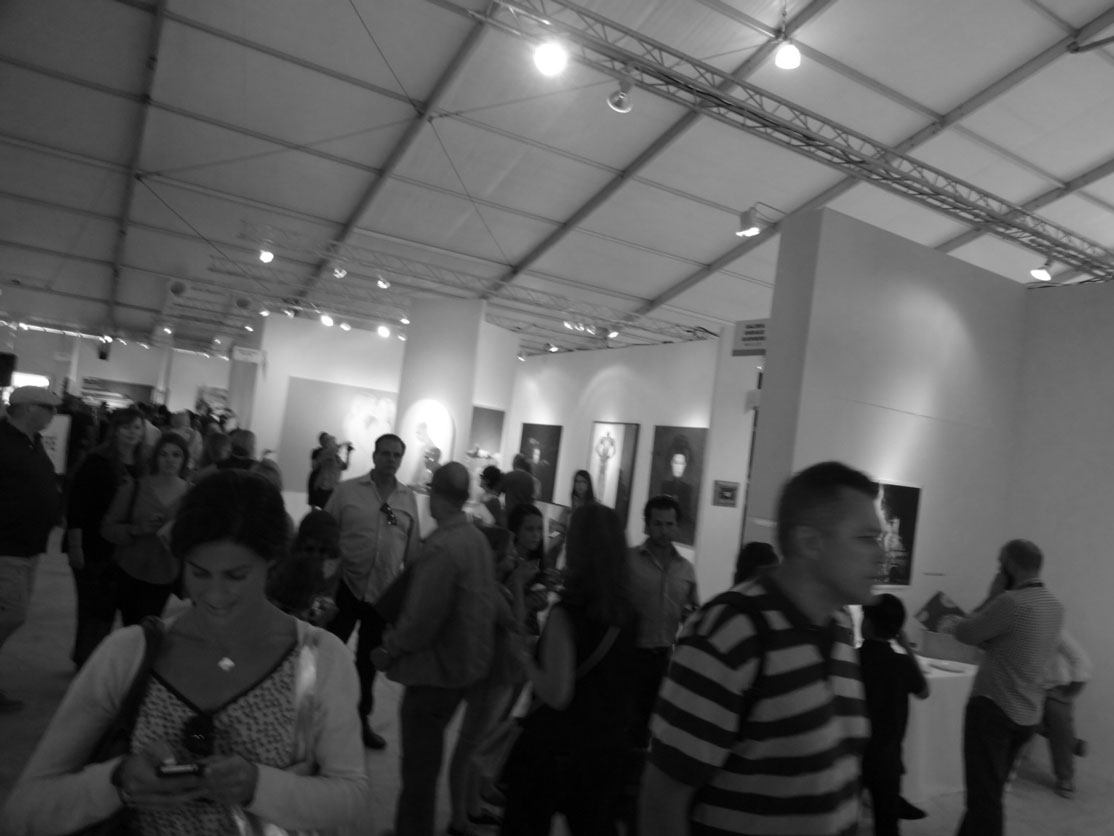 Visitors at Kavachnina Contemporary booth at ART MIAMI fair